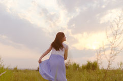Sunset, girl, wilderness Stock Images