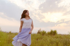 Sunset, girl, wilderness Royalty Free Stock Images