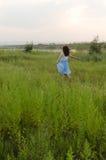 Sunset, girl, wilderness Stock Photos