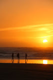 Sunset Girls. After a hot summers day the sky has a wonderful warm color as the sun goes down Royalty Free Stock Photography