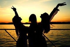 Sunset girls Stock Images