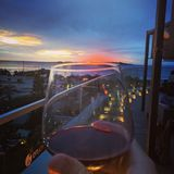 Sunset glass of wine and beach royalty free stock photos