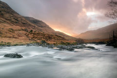 Sunset at Glen Etive. Glen Etive is in the Highlands of Scotland and the birthplace of James Bond. The River Etive rises on the peaks surrounding Rannoch Moor Royalty Free Stock Images