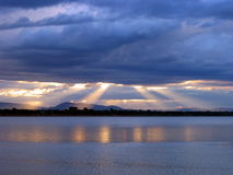 Sunset Glory. The sun rays lighten the colors of the Mekong river. Pakse. Laos royalty free stock images