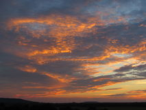 Gold Flecked Clouds at Sunset Stock Photography