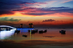 Sunset glow. China Hainan,shanya sunset silhouette and boats Stock Photo