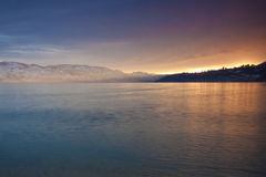 Sunset Glow. Over the mountains on the other side of Lake Okanagan Royalty Free Stock Photo