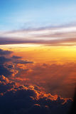Sunset glow. The toward evening, goes by plane in 10000 meter upper air soaring, outside the window is the multi-colored sunset glow Royalty Free Stock Photography