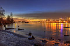 Sunset glow with city lights on New Year's Day. British columbia, Canada stock photography