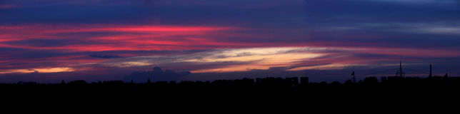 The sunset glow. In dark blue sky Royalty Free Stock Photo