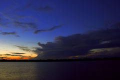 The sunset glow. In dark blue sky Royalty Free Stock Images