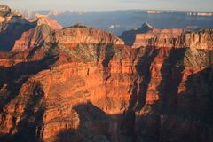 Sunset Glow on Grand Canyon Cliffs Stock Images