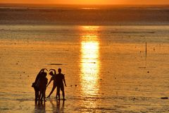 Sunset glow. Hsinchu, Taiwan seventeen kilometers of coastline, watching the sea park, dusk, purple, sunset, beach, Name Plates,color,ChienMu Hou Royalty Free Stock Photography