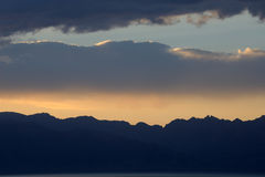 Sunset glow with snow mountains Royalty Free Stock Photography