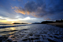 Sunset glow and waves Royalty Free Stock Images