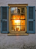Sunset Glowing Through an Old House Window Royalty Free Stock Photography