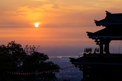 Sunset go down on temple roof stock images