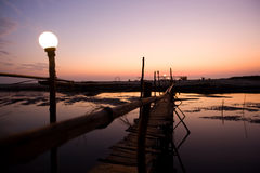 Sunset in goa. Wooden bridge over river Royalty Free Stock Image