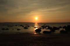 Sunset Goa sea. Sun rocks shells Stock Photos