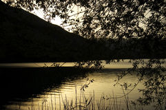 Sunset golden. Golden sunset over the mountains landscapes and the lake water royalty free stock photos