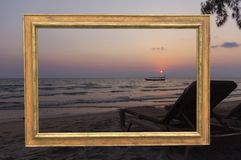 Sunset in the golden frame. Photograph of the sunset at the beach in the golden frame stock photo