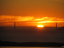 Sunset_Golden Gate Bridge. Sunset happening right on top of the Golden Gate Bridge. Photo taken from the East Bay hills, across the San Francisco Bay, California Royalty Free Stock Photos