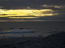 Golden hour sunset at the Marina state beach royalty free stock images