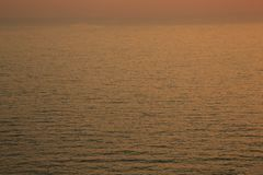 Sunset golden light reflection on sea wave ripple surface background. Abstract, tranquility, travel, serenity, romance, refresh, l. Oneliness, relaxation, rest stock photo