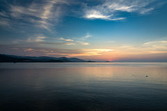 Sunset and golden light on the sea surface. Beautiful cloudy sunrise at sea landscape Stock Images