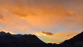 Sunset with a golden sky. And a very close cloud stock photos
