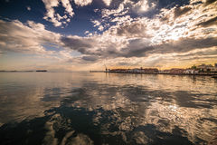 Sunset with Golden waters, Thessaloniki Port. Greece royalty free stock image
