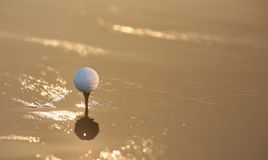 Sunset golf. With reflex Royalty Free Stock Photos