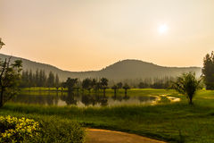 Sunset at golf course Royalty Free Stock Photography