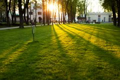 Sunset Gorky Park in Kharkov Ukraine May2018 with people and families from diverse communities sat on a bench. Sunset Gorky Park in Kharkov Ukraine May with Stock Photo