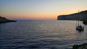 Sunset on Gozo Island. Sunset on Gozo, island in the Mediterranean Sea, Maltese archipelago, in a beautiful village Xlendi Royalty Free Stock Image