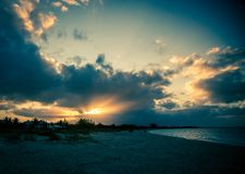 Sunset Grace bay beach. Cloud cover and sunset in grace bay club turks and caicos Royalty Free Stock Image