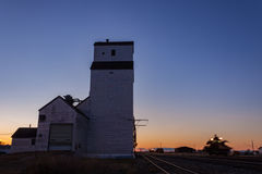 Sunset Grain Elevator with Rail Machinery Royalty Free Stock Image