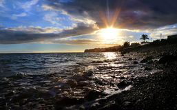 Sunset in Gran canary by the beach. In a warm sommer holiday with a fantastic view with dramatic clouds and calm sea royalty free stock images