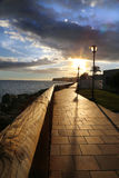 Sunset in Gran canary by the sea in a walking path way. Sunset in Gran canary by the sea. in a warm sommer holiday with a fantastic view with dramatic clouds stock photo