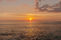 Sunset on Grand Cayman Island, Cayman Islands. Sunset on the Caribbean seashore of Grand Cayman Island, Cayman Islands, British Overseas Territory Stock Photo