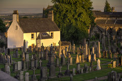 Sunset on a graveyard house Stock Photo