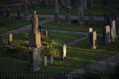 Sunset on a graveyard Royalty Free Stock Photography