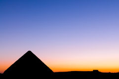 Sunset at Great Pyramid of Giza. One of the Seven Wonders of the Ancient World built entirely of limestone and is considered an architectural masterpiece Royalty Free Stock Photo