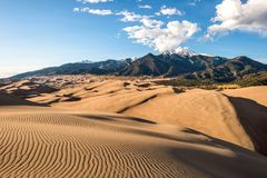 Sunset at Great Sand Dunes. Sunset view of sand waves at the top of Great Sand Dunes, Great Sand Dunes National Park & Preserve, Colorado, USA Stock Image