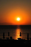 Sunset on the Greece beach Royalty Free Stock Image