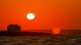 Sunset on the Greek coast against the island. Beautiful decline by the warm sea with the house backgroud sun stock footage