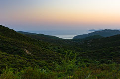 Sunset at greek coast in Sithonia, aerial photo from the top of a hill stock images