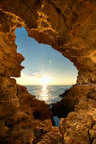 Sunset into grotto. Nature composition stock photo