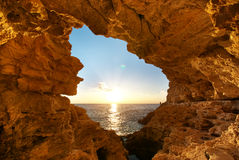 Sunset into grotto Royalty Free Stock Images