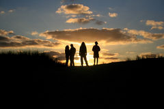 Sunset group friends Royalty Free Stock Photo